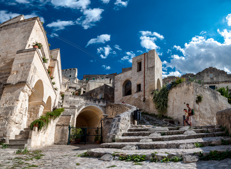 MATERA, ITALY – SEPTEMBER 15, 2014: Turists visit ancient town of Matera Sassi di Matera. The city is a UNESCO World Heritage site and European Capital of Culture for 2019
