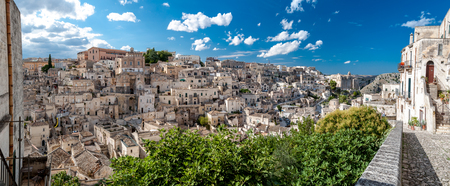 MATERA, ITALY – SEPTEMBER 15, 2014: Panoramic view of Sassi di Matera ancient town from Piazza Duomo. The city is a UNESCO World Heritage site and European Capital of Culture for 2019