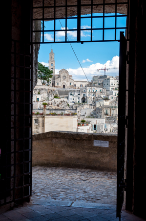 MATERA, ITALY – SEPTEMBER 15, 2014: Passage into old Sassi di Matera from Piazza Vittorio Veneto. The city is a UNESCO World Heritage site and European Capital of Culture for 2019 Editorial