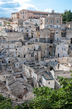 MATERA, ITALY – SEPTEMBER 15, 2014: Street panoramic view of buildings in ancient Sassi di Matera. The city is a UNESCO World Heritage site and European Capital of Culture for 2019 Editorial