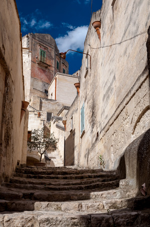 rupestrian: MATERA, ITALY – SEPTEMBER 15, 2014: Street view of Via San Martino in Matera ancient town. The city is a UNESCO World Heritage site and European Capital of Culture for 2019 Editorial