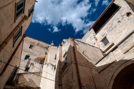 Street view of buildings in ancient town Sassi di Matera - Italy