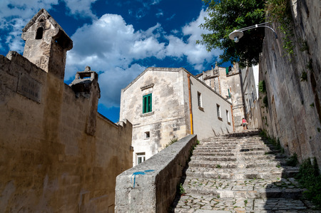 MATERA, ITALY – SEPTEMBER 15, 2014: Street view of stairs in ancient Sassi di Matera. The city is a UNESCO World Heritage site and European Capital of Culture for 2019 Editorial