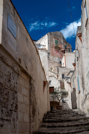 MATERA, ITALY – SEPTEMBER 15, 2014: Street view of Via San Martino in Matera ancient town. The city is a UNESCO World Heritage site and European Capital of Culture for 2019 Editorial