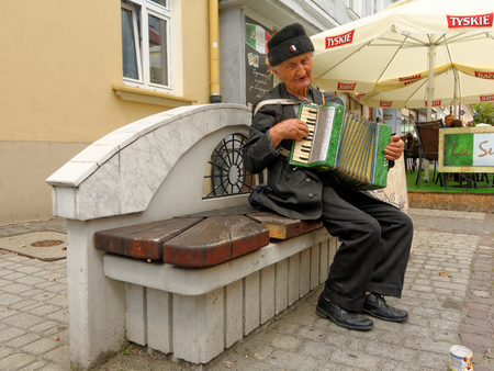 own: RZESZOW, POLAND - AUGUST 15 Nice older man playing the accordion and singing his own songs on 3 Maja Street, August 15, 2016.