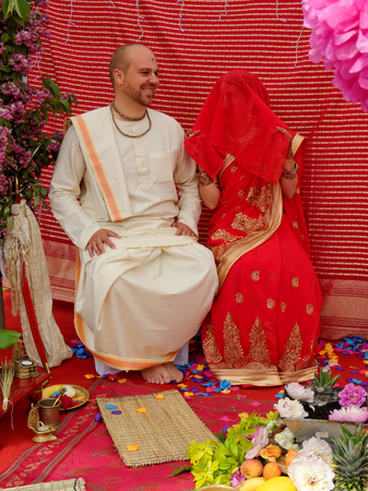BUSHEY, JUNE 19: Hindu wedding in the Vedic tradition, England, UK 2016. The bride and groom before the marriage ceremony.