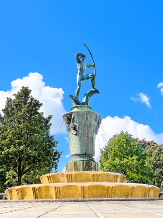 A fountain with a statue of Apollo in Coronation Garden, Dudley, UK.