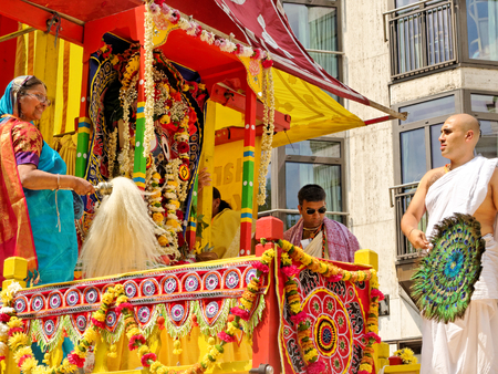 LONDON - JUNE 18: The cart festival called Rathayatra in London June 18, 2017. Deity called Jagannatha adored by the priests by tail yak and peacock feathers. Editorial