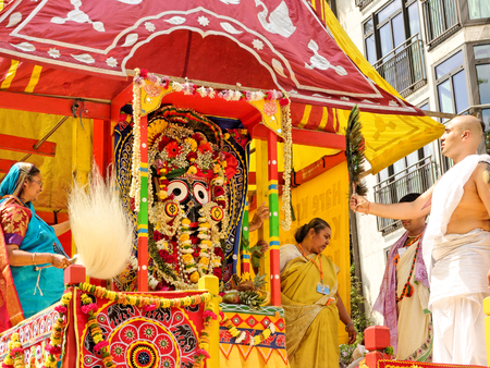 LONDON - JUNE 18: The cart festival called Rathayatra in London June 18, 2017. Deity called Jagannatha adored by the priests by peacock and featherstail yak .