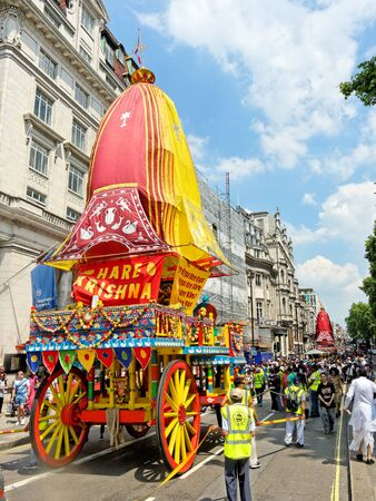 overcrowded: LONDON - JUNE 18: The cart festival called Rathayatra in London June 18, 2017. Cart on a overcrowded Piccadilly street