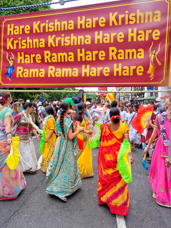 LONDON - JUNE 18: The cart festival called Rathayatra in London June 18, 2017. Every cart is accompanied by a chanting party, dancing in sari on the street.