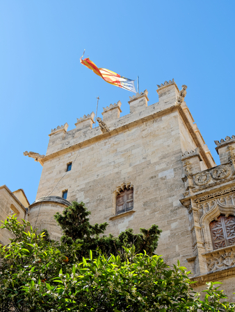 VALENCIA, APRIL 09: La Lonja de Valencia masterpiece of Gothic civil architecture. SPAIN 2018. The tower with the Valencia flag.