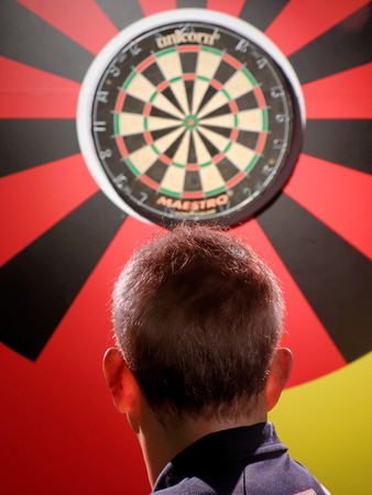 BLACKPOOL, JANUARY 14: Madame Tussauds, UK 2018. Philip Douglas Taylor - English retired professional darts player, focused on the throw to the target.