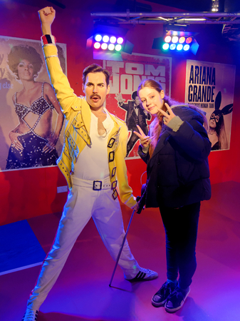 BLACKPOOL, JANUARY 14: Madame Tussauds, UK 2018. Wax figure of Freddie Mercury with a posing girl.