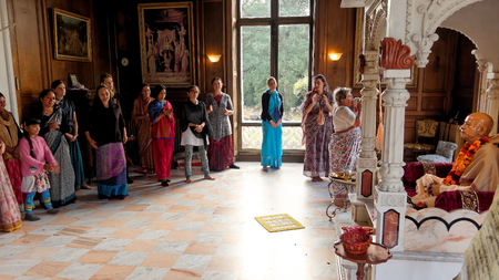 NEW MAYAPUR, AUGUST 15: Morning ceremony in the Hare Krishna temple, FRANCE, 2018. The devotee blows into a conch after offering arati to the spiritual master.
