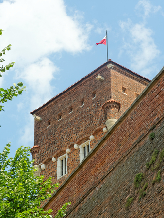 KRAKOW, MAY 29: Wawel Royal Castle, POLAND 2018. Thieves Tower with the flag of Poland on the top.