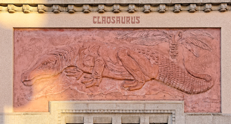 BERLIN, AUGUST 09: A wall surrounding the ZOO in Berlin, GERMANY 2017. Claosaurus in the rays of the setting sun.
