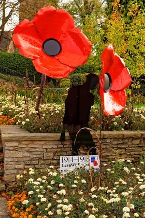 Sutton Coldfield, October 13: Remembrance poppy and soldiers black shape, UK 2018 Redakční