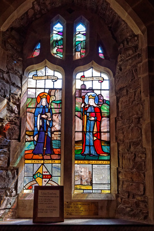 Historic stained glass windows inside the Saint Twrogs Church in Maentwrog, Snowdonia, Wales, April 11, UK 2018