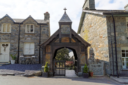 Entrance to the church through the clock tower in the village of Maentwrog in the mountains of Snowdonia, Wales, April 11, UK 2019 Editorial