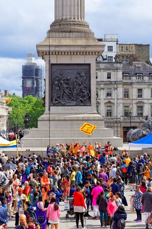 The cart festival called Rathayatra in London, People looking at festival stage placed under the Nelsons Column. June 16, UK 2019