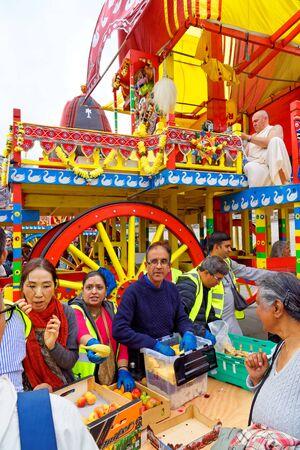 The cart festival called Rathayatra in London, free fruit for everyone. June 16, UK 2019