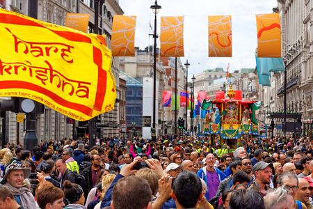 The cart festival called Rathayatra in London, Flag of Hare Krishna. June 16, UK 2019