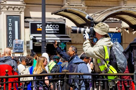 The cart festival called Rathayatra, Photographer with the camera takes pictures. June 16, UK 2019