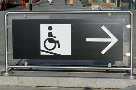 Information board for disabled people in a wheelchair to show the right way. Stok Fotoğraf - 157389662