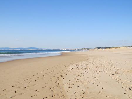 Beach at Costa da Caparica Stock Photo