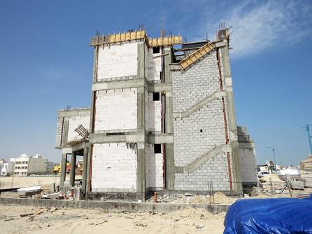 al: House under construiction in Al Khiran