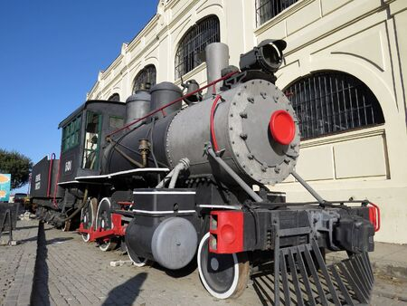 Restored Steam locomotive outside the old docks and Almacenes San Jose Artisan Market in Havana, Cuba