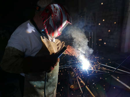 Worker welding iron
