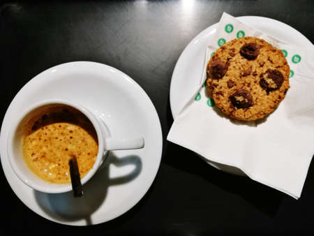 Espresso and a cookie with chocolate chips