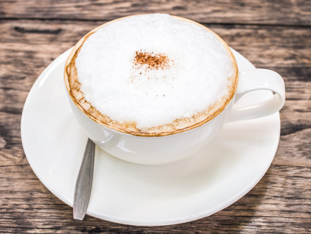 cappuccino cup: Cup of cappuccino coffee on wood background Stock Photo