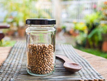 coriander seeds: Dried coriander seeds on bottle