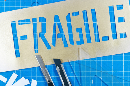 Stencil in table photo for your painting projects or stencil publications. Foto de archivo