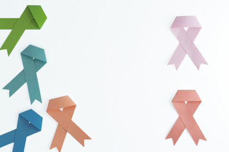Set of lymphoma, colon, prostate, uterus, breast, and leukemia cancer ribbons made with paper on white background.