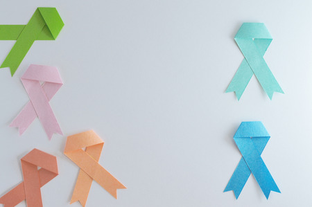 Another set of strips of lymphoma, colon, prostate, uterine, breast and leukemia cancer made of paper with white background.