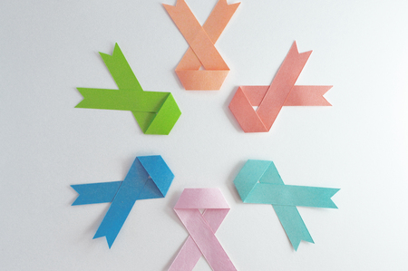 Circle of cancer ribbons made of paper with white background. Stock Photo