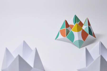 Origami figure paper in white background, ideal for your education projects or origami topics in your publications. Stock Photo