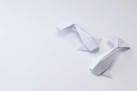 Origami figure paper in white background 版權商用圖片