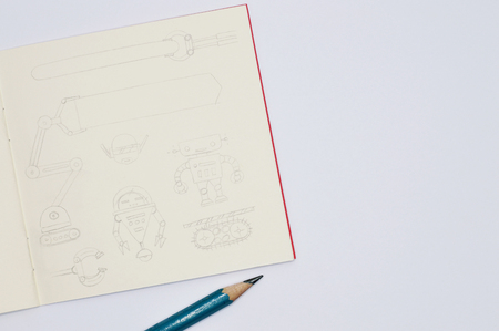 Square sketchbook with handmade drawings of robots, pencil line style on white background. Archivio Fotografico - 121015636