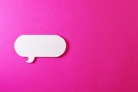 Paper bubble speech shapes on color background