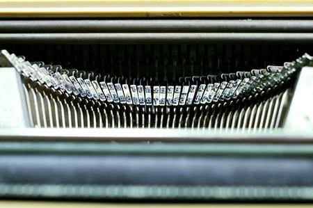 Close up of typewriter metallic letters