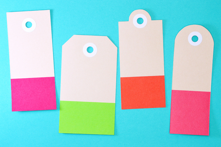 Paper tag on color background, ideal for your shopping projects or business topics.