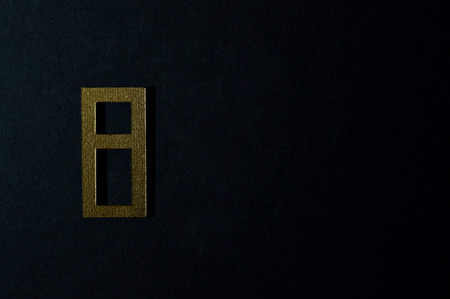 Template of gold sans serif number on dark background.