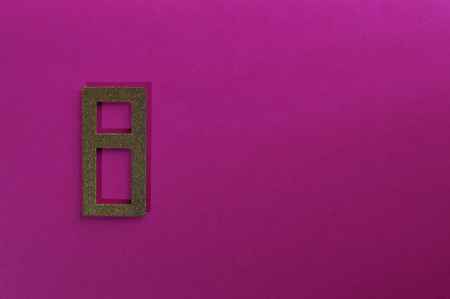 Template of gold sans serif number on pink background.