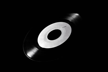 Black and white template of old vinyl disc on dark background.