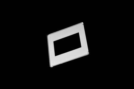Black and white template of old reversal film frames on dark background.